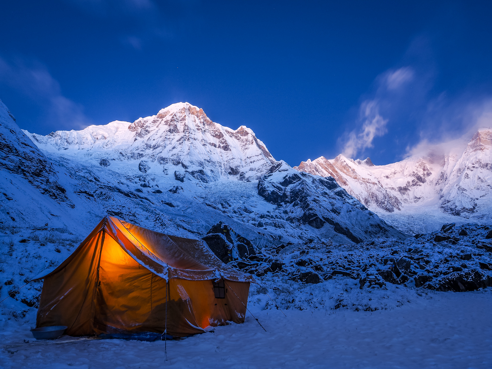 Tent in the mountains on a winter night with bright moon, Annapu