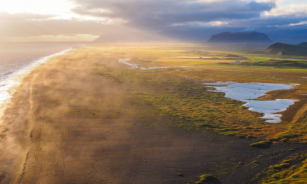 coastline of iceland during sunset. Dyrholey, Iceland