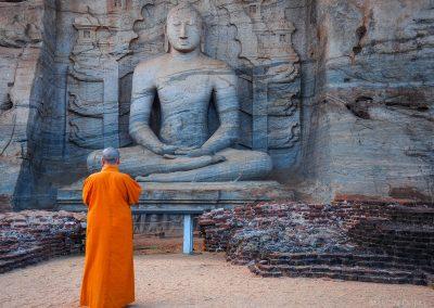 Unique monolith Buddha statue in Polonnaruwa temple and monk  -